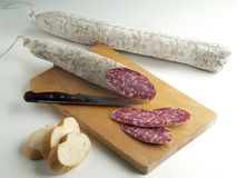 Salami Sliced on Cutting board and bread Stock Images