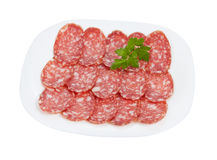 Salami sliced on a plate isolated Royalty Free Stock Photos