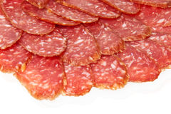Salami slices. Tasty salami slices white isolated Stock Image