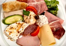 Salami slices and cheese Stock Image