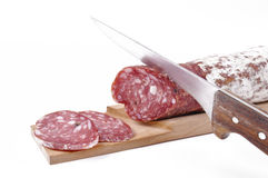 Salami slices on cutting board Royalty Free Stock Photos