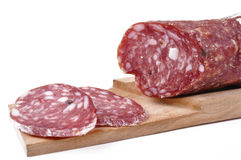 -Salami slices on cutting board Royalty Free Stock Photo