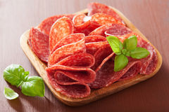 Free Salami Slices In Wooden Plate Stock Images - 51830174