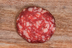Salami slices with pepper and Royalty Free Stock Image