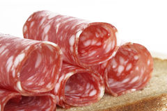 Salami slices rolled on bread Stock Photo