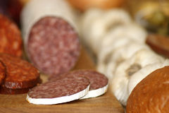 Salami and  slices salami on a timber board Royalty Free Stock Image