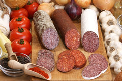 Salami and   slices salami on a timber board Stock Photography