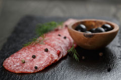 Salami slices slate board stock images