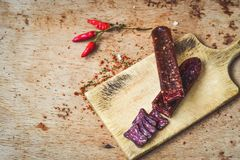 Salami. Slices Salami and spices as a rustic lunch royalty free stock photos