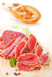 Salami slices on wooden board. Stock Images