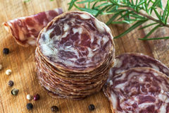 Salami slices on a wooden table Royalty Free Stock Photography