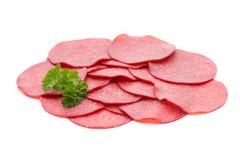 Salami smoked sausage one slice isolated on white background cut Royalty Free Stock Image