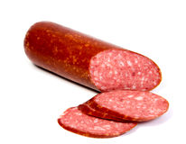 Salami smoked sausage slices isolated on Royalty Free Stock Photography