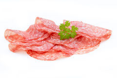 Salami smoked sausage slices isolated on white background cutout Stock Images
