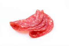 Salami smoked sausage slices isolated on white background cutout Royalty Free Stock Photography