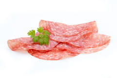 Salami smoked sausage slices isolated on white background cutout Stock Photos