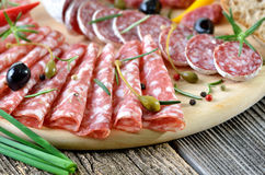 Salami snack. Snack with various kinds of salami, spiced with rosemary and pepper royalty free stock photography