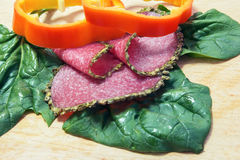 Salami with spices, spinach, bell pepper rings Stock Photo