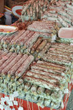 Salami sticks piled heap in the street market Stock Image