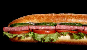 Salami sub sandwich. On black background Stock Image