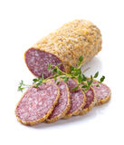 Salami with thyme isolated on a white background Stock Photo