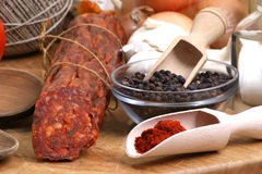 salami on a timber board Stock Images