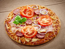 Salami and tomato pizza Royalty Free Stock Image