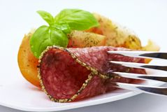 Salami with Tomatoes Stock Photography