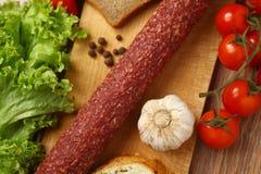 Salami and vegetables Stock Photos
