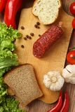 Salami and vegetables Stock Image