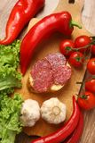 Salami and vegetables Stock Images