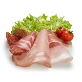 Salami, vegetables and tomatoes Stock Photos