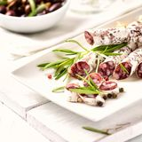 Salami with Walnuts and Rosemary on a plate stock photography