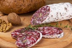Salami with walnuts and thyme bread Royalty Free Stock Image