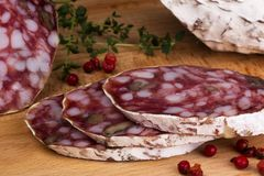 Salami with walnuts and thyme bread Royalty Free Stock Photos
