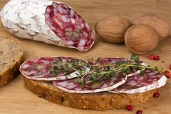 Salami with walnuts and thyme bread Royalty Free Stock Photo