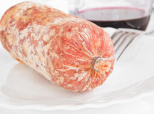 Salami on white dish. Royalty Free Stock Images