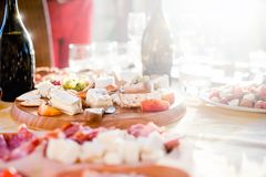 Salami, wine, cheese, prosciutto appetizer with caprese salad Royalty Free Stock Image