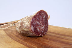 Salami on wood trencher Royalty Free Stock Image
