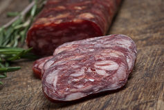 Salami on wooden background Stock Images