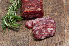 Salami on wooden background Royalty Free Stock Photography