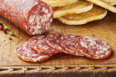 Salami on a Wooden Board Stock Photos