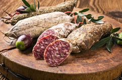 Salami on the Wooden Board Royalty Free Stock Photo
