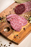 Salami and on wooden cutting Board Royalty Free Stock Photography