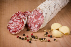 Salami   on a wooden table Stock Photo