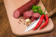 Salami   on a wooden table Stock Photos