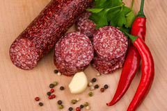Salami   on a wooden table Stock Image
