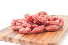 Salamis on wooden board Stock Photography