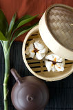 Salapao chinese bun. In bamboo tray with tea pot Stock Images