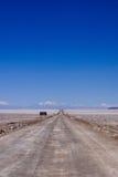 Salar de Atacama in Chile. A road leading through the salt flats in the Atacama desert in northern Chile Royalty Free Stock Photos